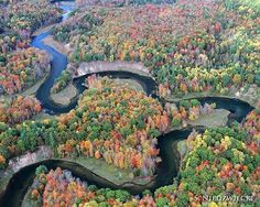 The Manistee River winding through the lovely fall colors of the north Michigan…