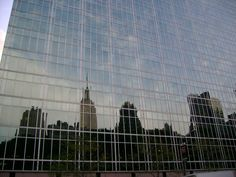 The standard-issue shot of the New York skyline reflected in glass...
