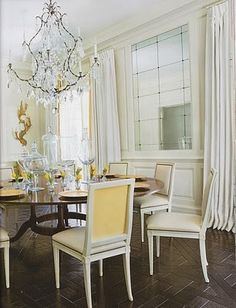 Yellow and White Chairs and beautiful chandelier
