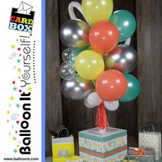 NEW from Balloon It … the Balloon It Yourself! CardBox. It's 4 feet of air-filled balloon bouquet goodness anchored in an XL CardBox with 100+ greeting card capacity. NO HELIUM The perfect centerpiece for every gift table. #cardbox #balloon #babyshowerconnoisseur #babyshower Balloons On Sticks, Helium Balloons, Balloon Stands, The Balloon, Balloon Ideas, Gift Table, A Table, Balloon Basket, Celebration Day