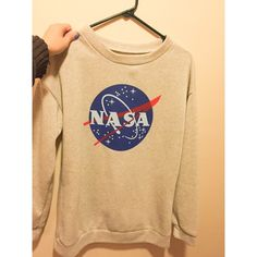 NASA sweater Very soft and comfy NASA sweater. My grandmother bought this for me and it doesn't have any tags on it so I'm not sure where it's from. NOTE: the neck line is wide so if you're wearing a shirt underneath, it will be exposed. Tops Sweatshirts & Hoodies