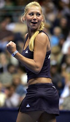 Tennis player Anna Kournikova celebrates a point during World TeamTennis event.