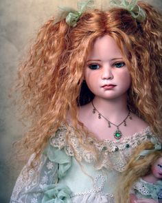 Doll by Tom Francirek Andre Oliveira - They use the finest fabrics, both antique and modern, French lace, silk ribbons, silk and cotton are best. The eyes of each porcelain doll are hand-drawn.