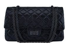 "Chanel So Black Classic Reissue 2.55 Double Flap 225 Bag - One of the most sought-after models within the house of Chanel is the reissue line, with the thick, smooshy distressed calfskin leather that contrasts nicely with the timeless, elegant antiquated Black hardware chain of the reissue strap.  The 9.5-inch ""medium"" 225 size Reissue 2.55 holds your basic essentials while giving you an elegant, understated Chanel look.  In glazed black calfskin, reflects the light ever so slightly wit..."