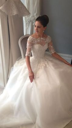 Love the fairytail style dress and adding the lace sleeves and neck just makes it perfect.