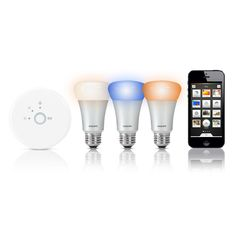 Philips's Hue wireless LED bulb can display different tones of color, and is controlled by your smartphone or tablet. Just pick the lights or lamps you want to give the Hue makeover and screw the wireless bulbs in. Ipod, Smartphone, Apple Store Uk, Best Smart Lights, Phillips Hue, Ipad Accessories, Smart Home Technology, Home Gadgets, Ideas