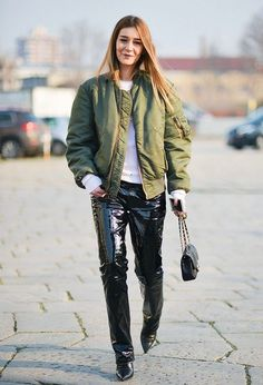 Chiara Capitani in an MA1 flight jacket, patent black trousers and heels.