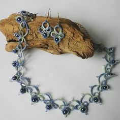Tatting necklace earrings with beads.