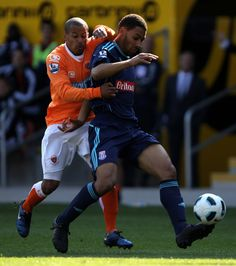 Blackpool 0 Stoke City 0 in April 2011 at Bloomfield Road. DJ Campbell and Ryan Shotton in action Stoke City, Blackpool, Dj, Action, Football, Running, Sports, Soccer, Hs Sports