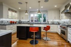 We think the kitchen in this San Mateo beauty, with its granite and quartzite counters and great stainless steel appliances, is pretty close to perfect. http://pacunion.us/325_22ndAve