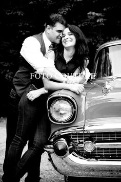 Couples hug and smile on antique classic cars!
