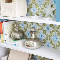 Bookshelf with wrapping paper background.