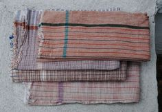 assorted sizes 100% cotton khadi a variety of yarn dyed towels in plain weave assorted shadesand patterns no two are exactly the same *khadi : fabric woven by hand of hand-spun yarn