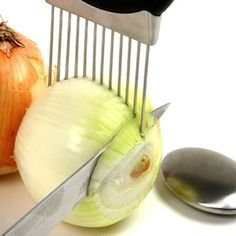 50 Useful Kitchen Gadgets You Didn't Know Existed -- onion holder! So you can cut it without the stinky hands. Great gift ideas.