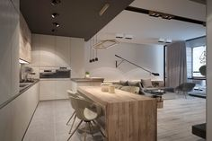 A dark drop ceiling defines the kitchen space – here, wood furniture takes the spotlight with a large slab table and matching cabinetry. Kitchen On A Budget, Home Decor Kitchen, Kitchen Living, Kitchen Interior, New Kitchen, Home Interior Design, Home Kitchens, Interior Architecture, Natural Kitchen