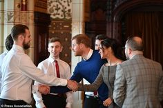 Prince Harry and Meghan Markle meet Only Boys Aloud (Ben Birchall/PA)...