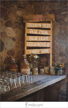 Rustic wedding bar signage.  An important element, to deter guests from constantly inquiring what is available at the bar.