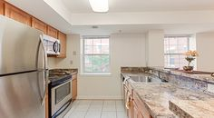 The Oaks Apartments | Southeast Washington, DC | Affordable Apartments in DC | Anacostia Neighborhood | Granite Covered Counters | Laminate Wood Flooring | Renovated Community | Kitchen |