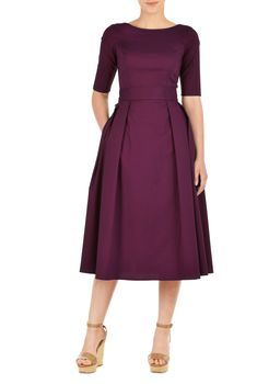 Our stretch cotton poplin dress is cinched in with an elasticated self-belt and a large bow at the back. The princess-seamed bodice and pleated skirt are classically flattering, while pockets and a midi-length hemline offer modern elements.
