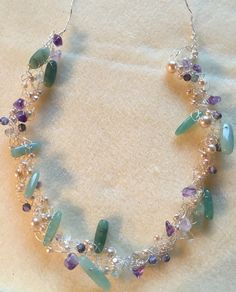 A wire crochet necklace of my own design, using vintage fresh water pearls, amethyst chips and beads from my stash.