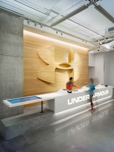A.R.E. - Association for Retail Environments...Beautiful wooden wall at this Under Armour store...  #mainebucket #woodendisplays