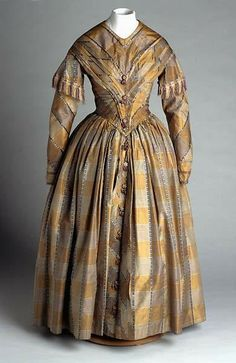 Plaid taffeta dress with fringe and tassels worn by Laura Caroline Battle after her marriage to Charles Vermuele Phillips in Chapel Hill, 8 Dec 1847.  Collections of the NC Museum of History, Accession number 1923.5.5 http://www.findagrave.com/cgi-bin/fg.cgi?page=grGRid=53088801