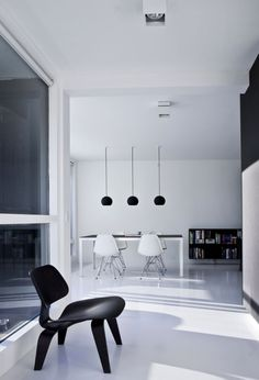 This beautifully minimalistic penthouse was created by Norm Architects and is based in Copenhagen. The architects went for an open plan design with large windows to create the feeling of space. They then of course painted it white to make the penthouse appear larger. The accent colour used was black and was used in some bits of the furniture and some of the walls which divides the house. It's a very contrasting but common way for minimalistic houses to feel open and spacious but at the same…