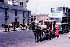 Old and new: A horse-drawn carriage is parked on Store Street in Dublin as a woman carries a small child inside, in front of an Aer Lingus-branded bus taking passengers to Dublin Airport, in The airport expanded rapidly during the Dublin Airport, Dublin City, Double Deck, Horse Drawn, Dublin Ireland, England Uk, Colour Images, Historical Photos, East Coast