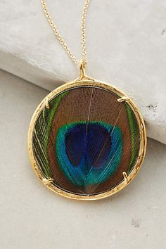 Peacock's Plume Pendant Necklace: isn't this necklace beautiful?? Well if it weren't for the fact that it's over $200, I would buy it lol from Anthropologie