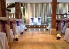 Ceremony area at the Barn at Bury Court. Flowers by Eden Blooms - love the storm lanterns.