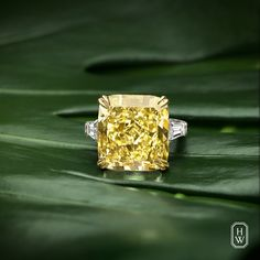 Radiate with all the warmth of the summer sun in a radiant-cut yellow diamond ring by #HarryWinston. #HighJewelry