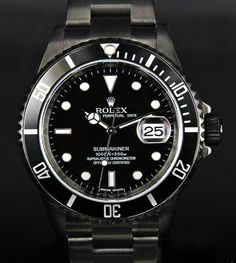 Montre Noire / Black Rolex.  I have never seen a black Rolex.  But I really want one now.  The only thing better would be a black Omega Planet Ocean.