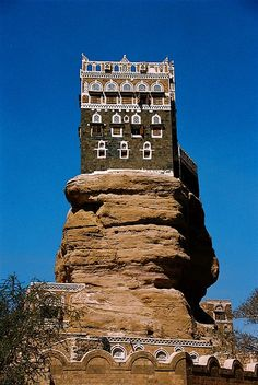 Head up to the top of the rock at the Wadi Dhar Rock Palace, Yemen