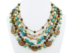 "BALI TREASURE NECKLACE  About this product:  16–21"" adjustable, 6-strand.  Spring/Summer 2012 Catalog, pg 23.      Item #: 82511  Price: $38.00"