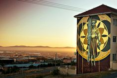 #anotherlightup by Faith47, Cape Town, South Africa. This new collaborative multi-story artwork 'Harvest' provides a visual feedback loop for those who view it; the wall lights up at night each time enough money is raised for one new light to be installed in a pathway of the informal settlement of Monwabisi Park in Khayelitsha, through the organisation VPUU (Violence Prevention through Urban Upgrading).