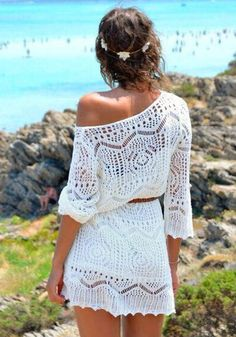 Fight the summer heat with this white crochet knit top. It features knitted cutout and a scoop neckline. It also comes with a brown belt that can help emphasize your curves.