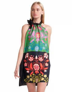 Silk halter dress in vibrant floral print. Dress ties with back silk chord at neck and falls above the knee.  Fabric content: 100% Silk  Care Instructions: Dry clean only