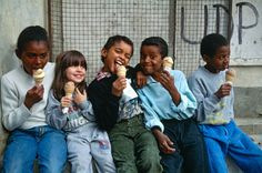 """africansouljah:  """"Thomas Hoepker  PORTUGAL. 1992. Lisbon. African imigrant Kids having ice-cream in the streets.  """""""