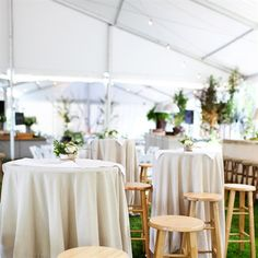 outdoor wedding-cocktail hour high tables and bar stools, guest can sit and converse over cool drinks