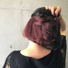 Romantic shades of maroon tucked below a dark matte shade for a peek of fun whenever you flip your hair!