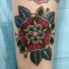 Mandala type flower on elbow maybe