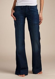 Lucky denim trousers with front slant pockets and back buckle.