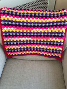 A personal favourite from my Etsy shop https://www.etsy.com/uk/listing/466293265/tutti-frutti-bobble-crochet-baby-blanket