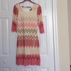 Cute dress Only worn once! It's petite medium. Very nice to wear to dress functions. Fresh of LA Dresses