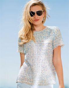 Couture trifft Nonchalance: Der lässige Kasack in charaktervollem Fancy-Tweed gehört zu den Top-Trends in dieser Saison