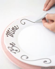 Melted chocolate, piped onto the edge of a plate, provides a delightful way to express romantic sentiments. Score a 12-inch parchment square...