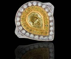 Fancy yellow Pear Shape Diamond