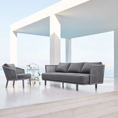 The Moments 3 Seater Sofa offers a modern design that exudes Scandinavian minimalism. Composed with a low cut frame and a platform base adorned with Cane-line Rope for a flexible lean and soft, plush cushions and pillows, the modern outdoor sofa is all around comfortable and inviting.