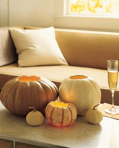 "Cute table votives from Martha Stewart! See the ""Pumpkin Votive Holders"" in our Thanksgiving Table Settings gallery Halloween Tipps, Fete Halloween, Holidays Halloween, Halloween Pumpkins, Mini Pumpkins, White Pumpkins, Halloween Veranda, Pretty Halloween, Small Pumpkins"