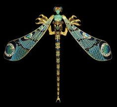 René Lalique; Dragonfly woman corsage ornament, c. 1897-1898; Metamorphosis, or change from one physical form to another, was a major theme for many Art Nouveau artists. Here, woman and insect are fused into an almost menacing creature with golden claws. The idea of the femme fatale, or dangerous woman, was a recurrent theme in many Art Nouveau creations.